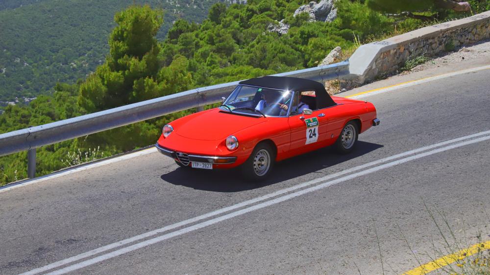 red Alfa Romeo Spider on Road