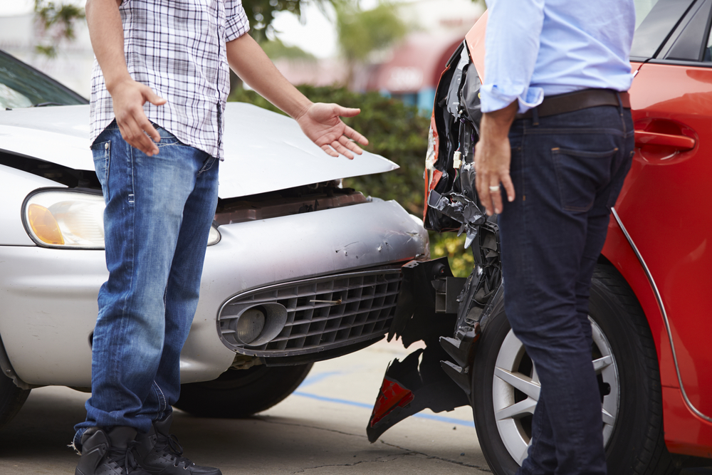 two men talking after car accident