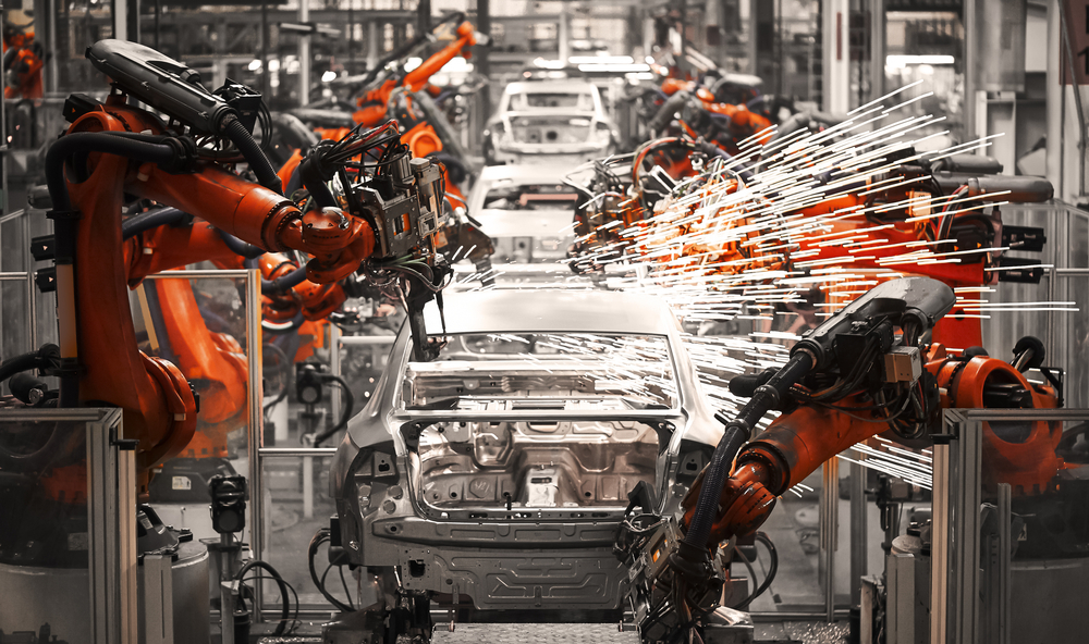 Factory robots manufacturing process for electric cars in action