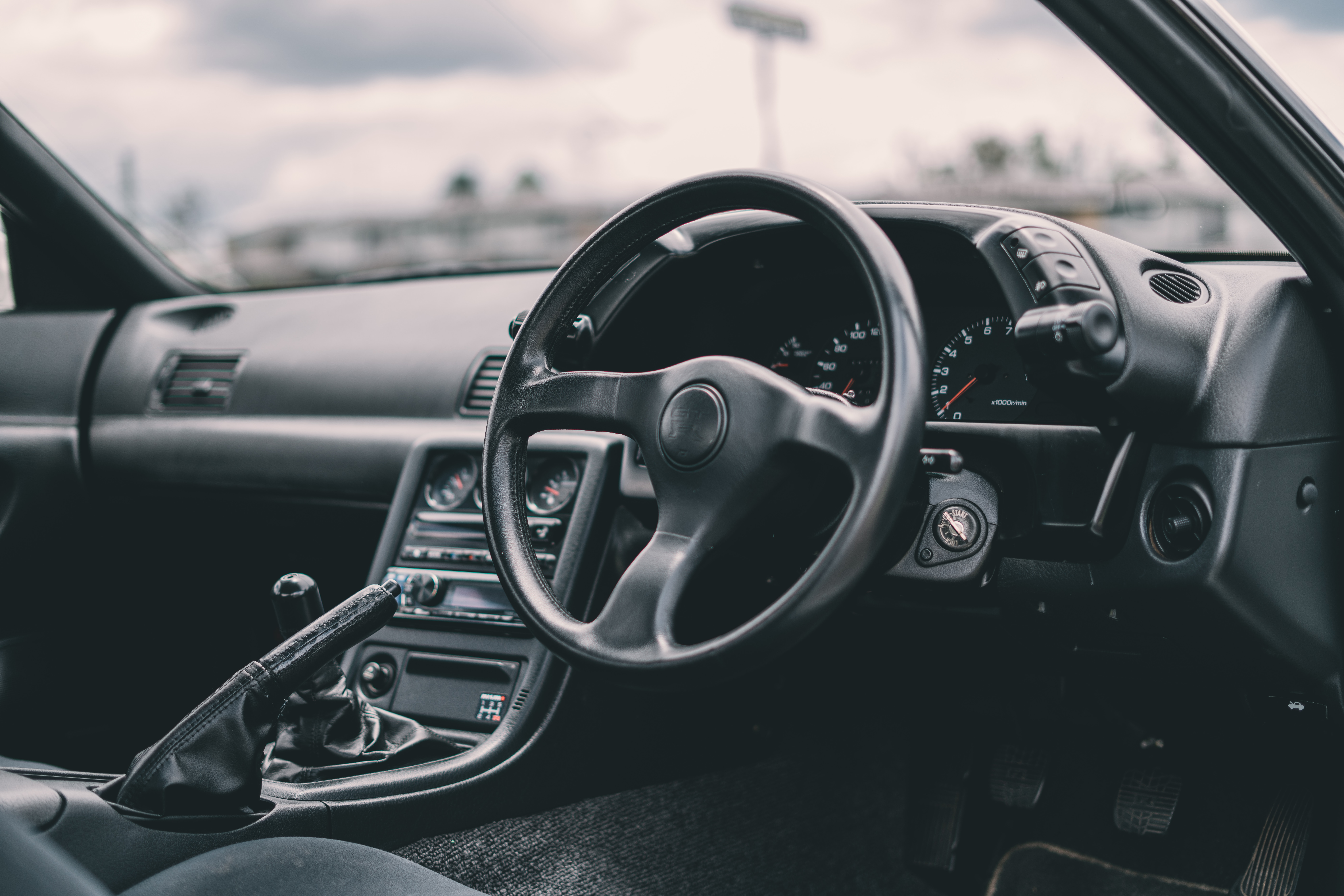 nissan GT-R JDM interior with right hand drive steering wheel layout.