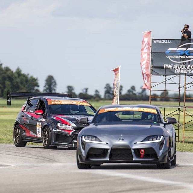 Toyota Supra racing at Toronto motorsports park in the summer.