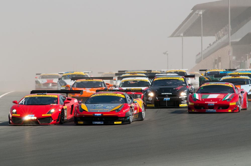 racecars racing on track