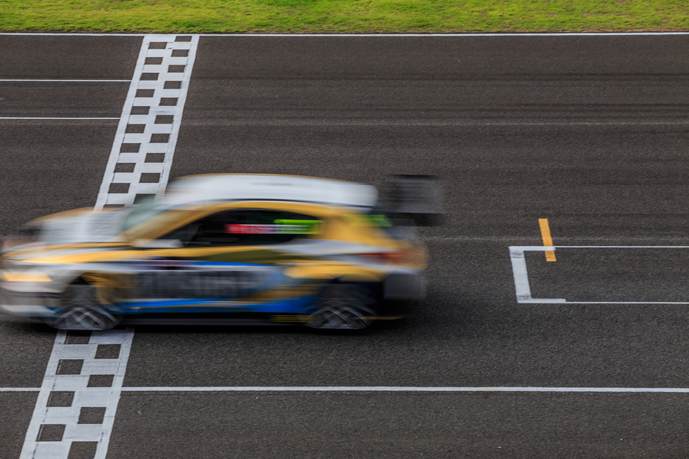 car on race track going fast